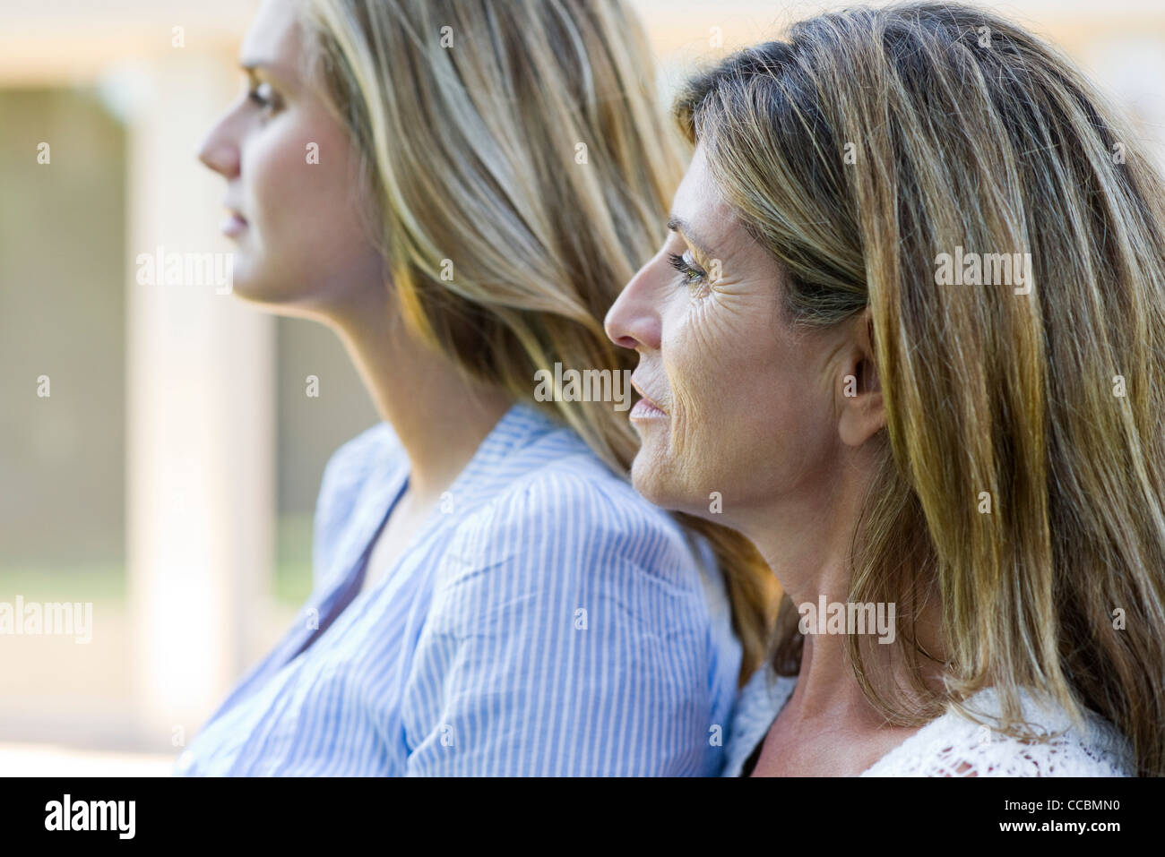 Mother and grown-up daughter, side view - Stock Image