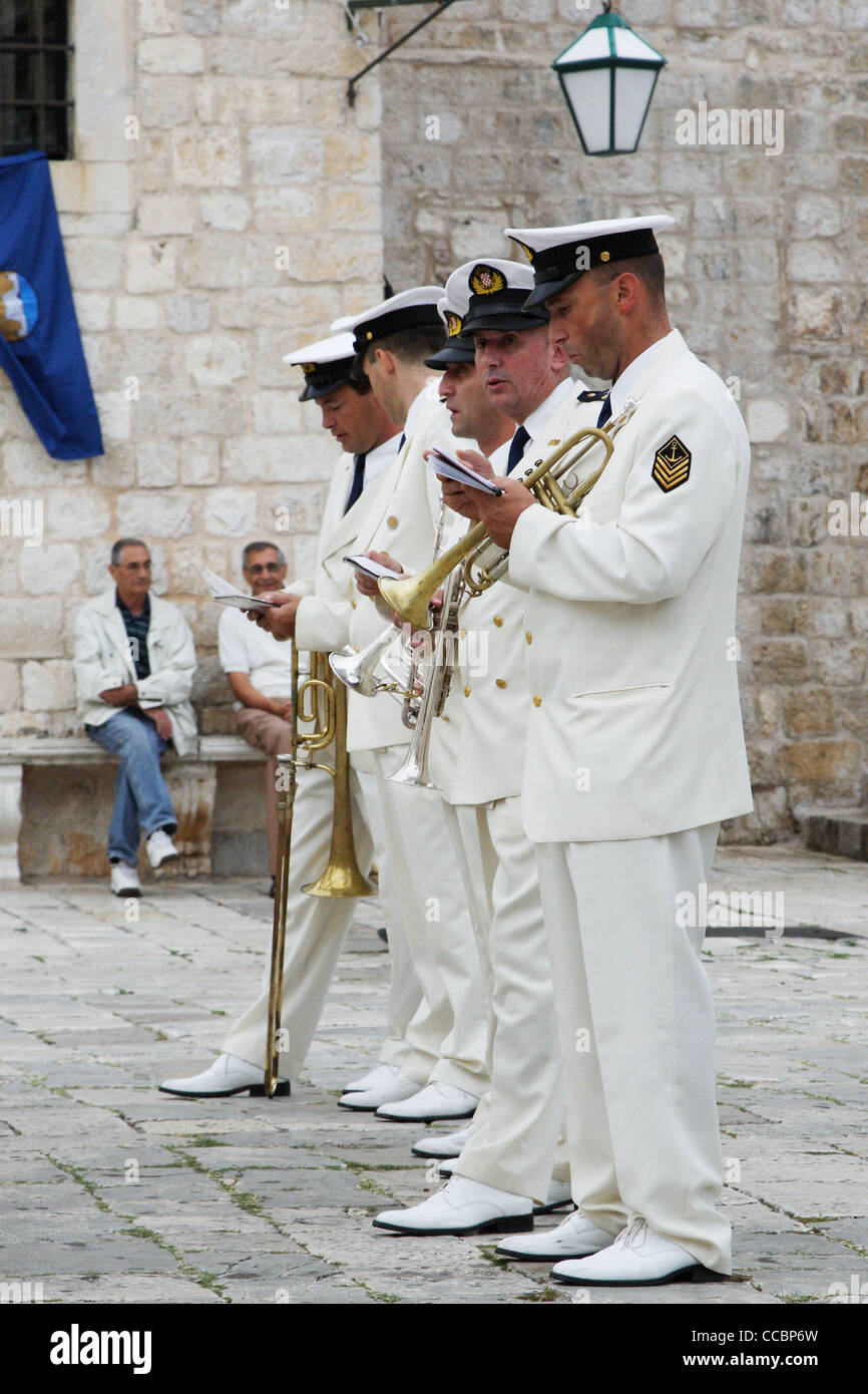 A brass band member reads his music during a break on St. Stephen's Day celebrations in Hvar, Croatia. - Stock Image