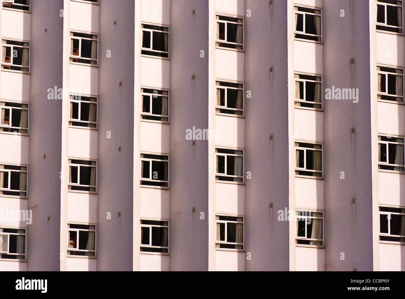Symmetric Symmetrical Symmetrically Pattern Patterns Windows In A Modern Concrete Building - Stock Image
