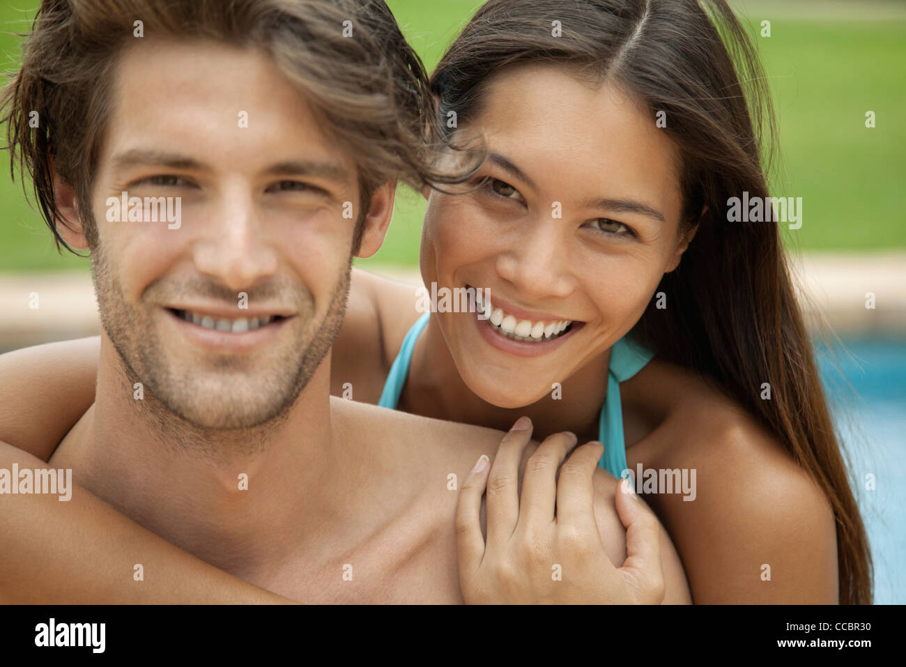 Couple embracing outdoors, portrait Stock Photo