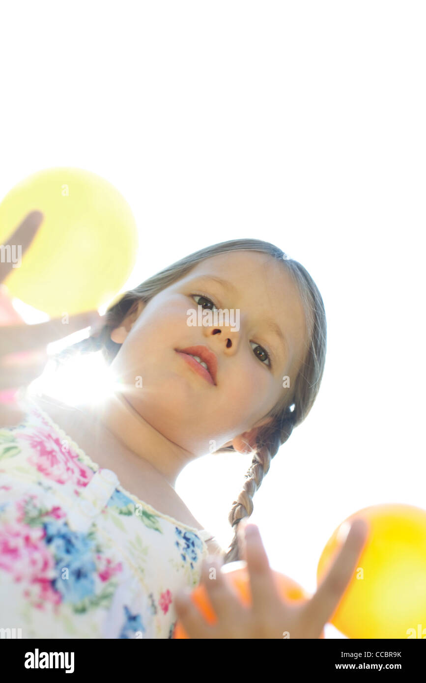 Girl with pigtails, directly below view - Stock Image
