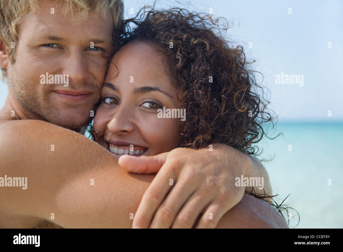 Couple embracing at the beach, portrait Stock Photo
