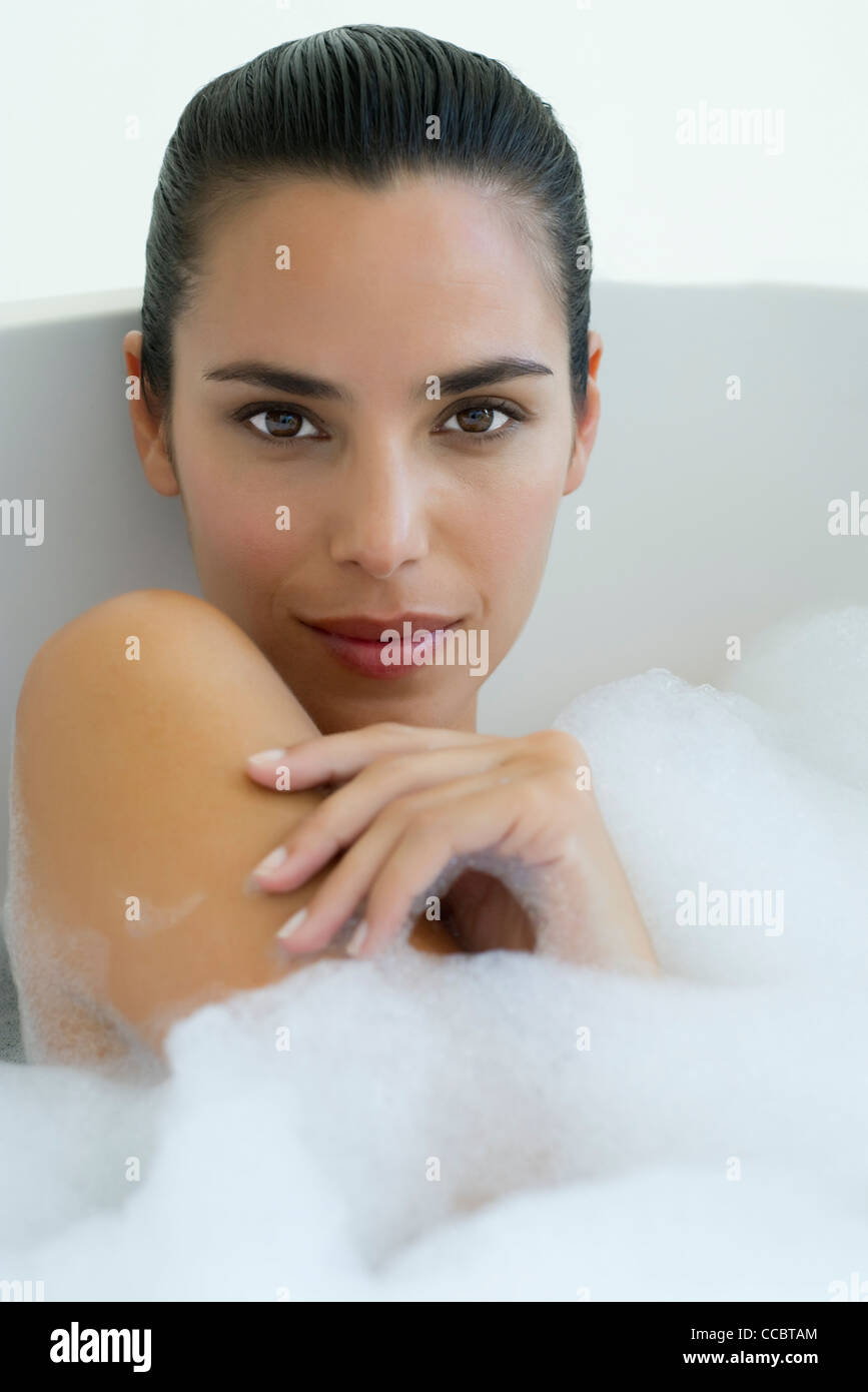 Woman taking bubble bath - Stock Image