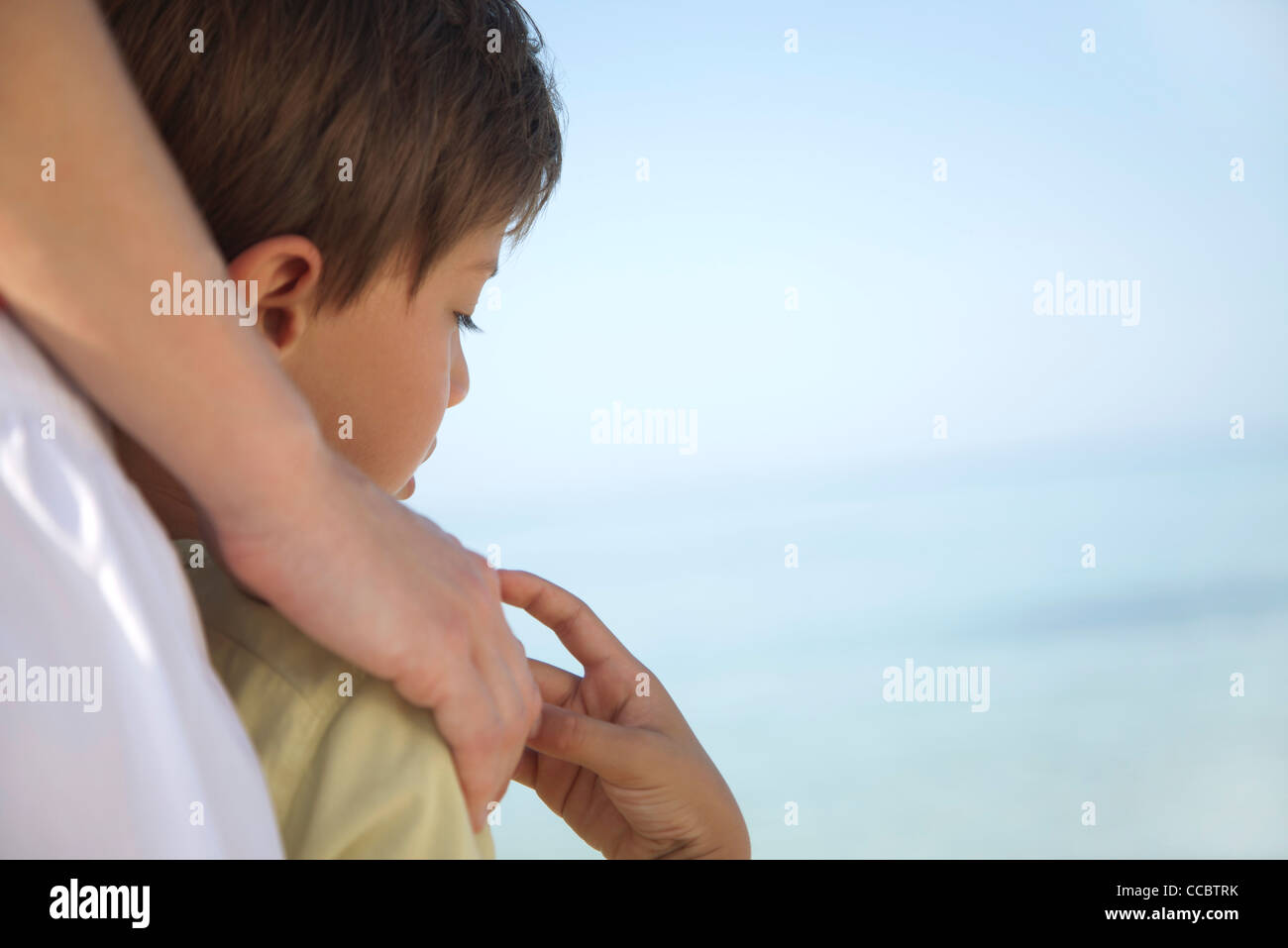Boy holding mother's hand, cropped - Stock Image