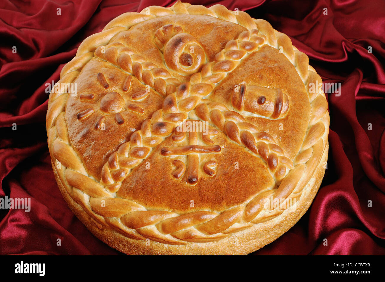 Serbian Orthodox Traditional Christmas Bread Known as a Cesnica. - Stock Image