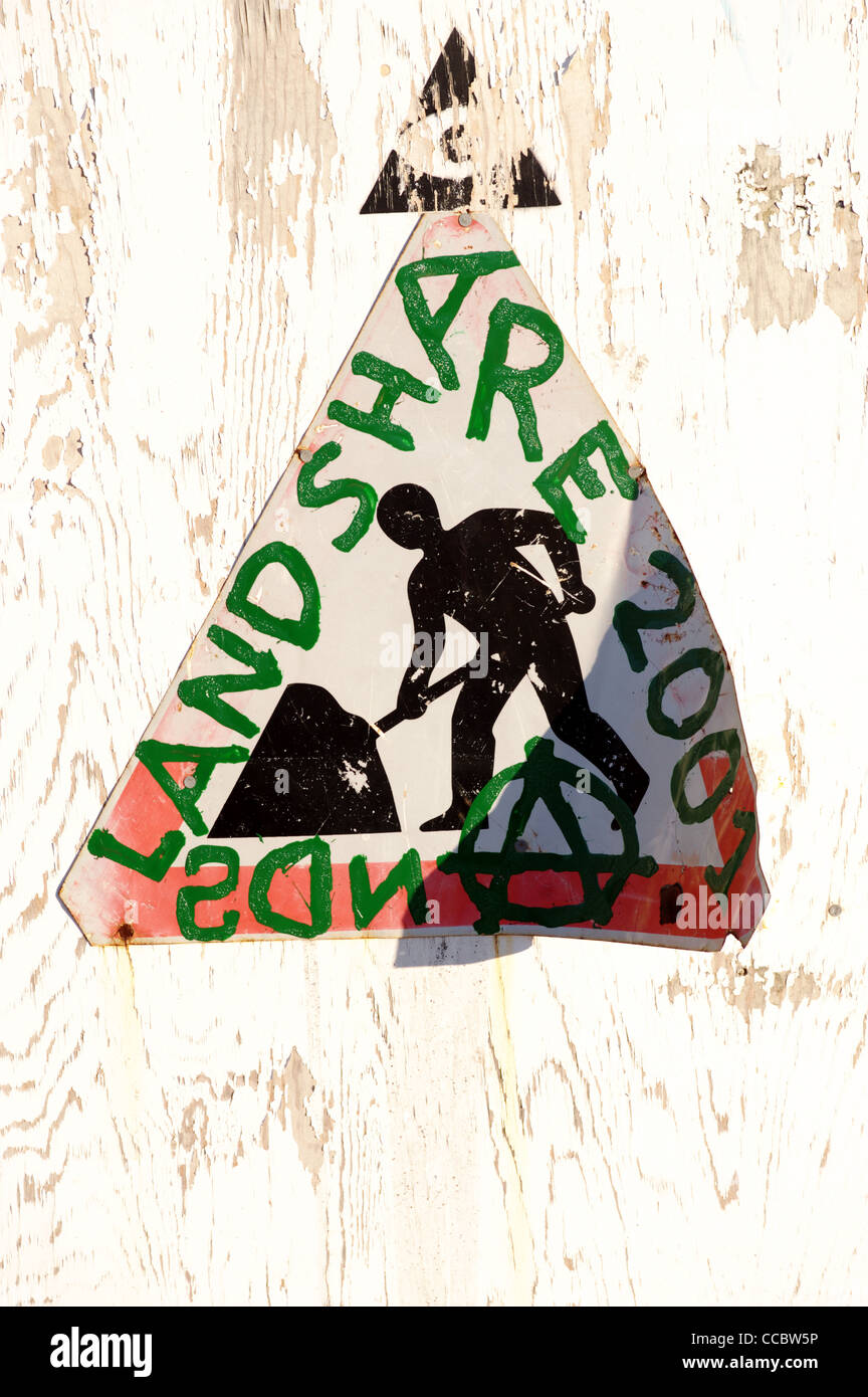 Altered road sign, with words added Land Share 2001 and an anarchist symbol - Stock Image