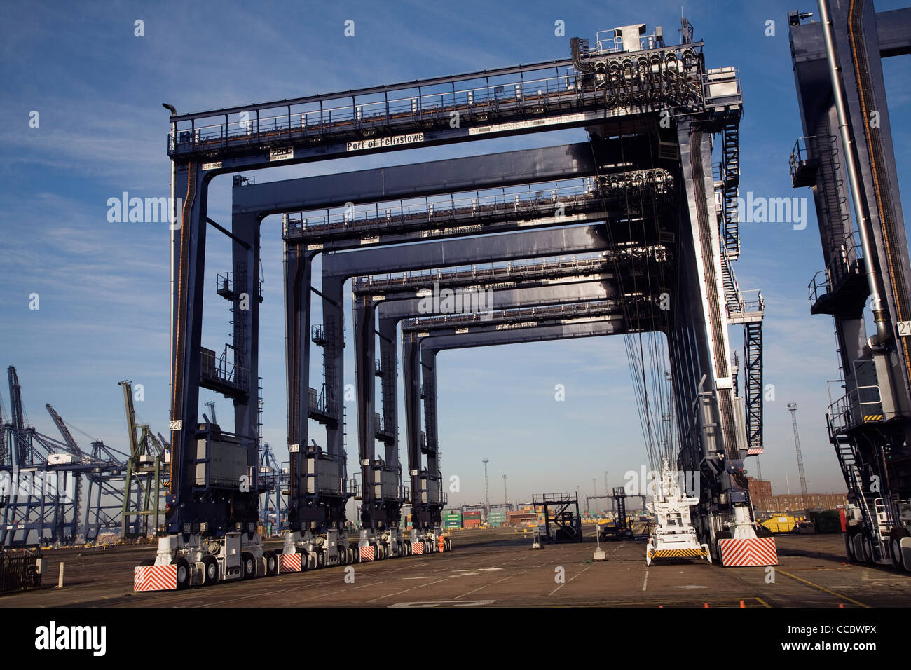 Container spreader crane, Port of Felixstowe, Suffolk, England - Stock Image