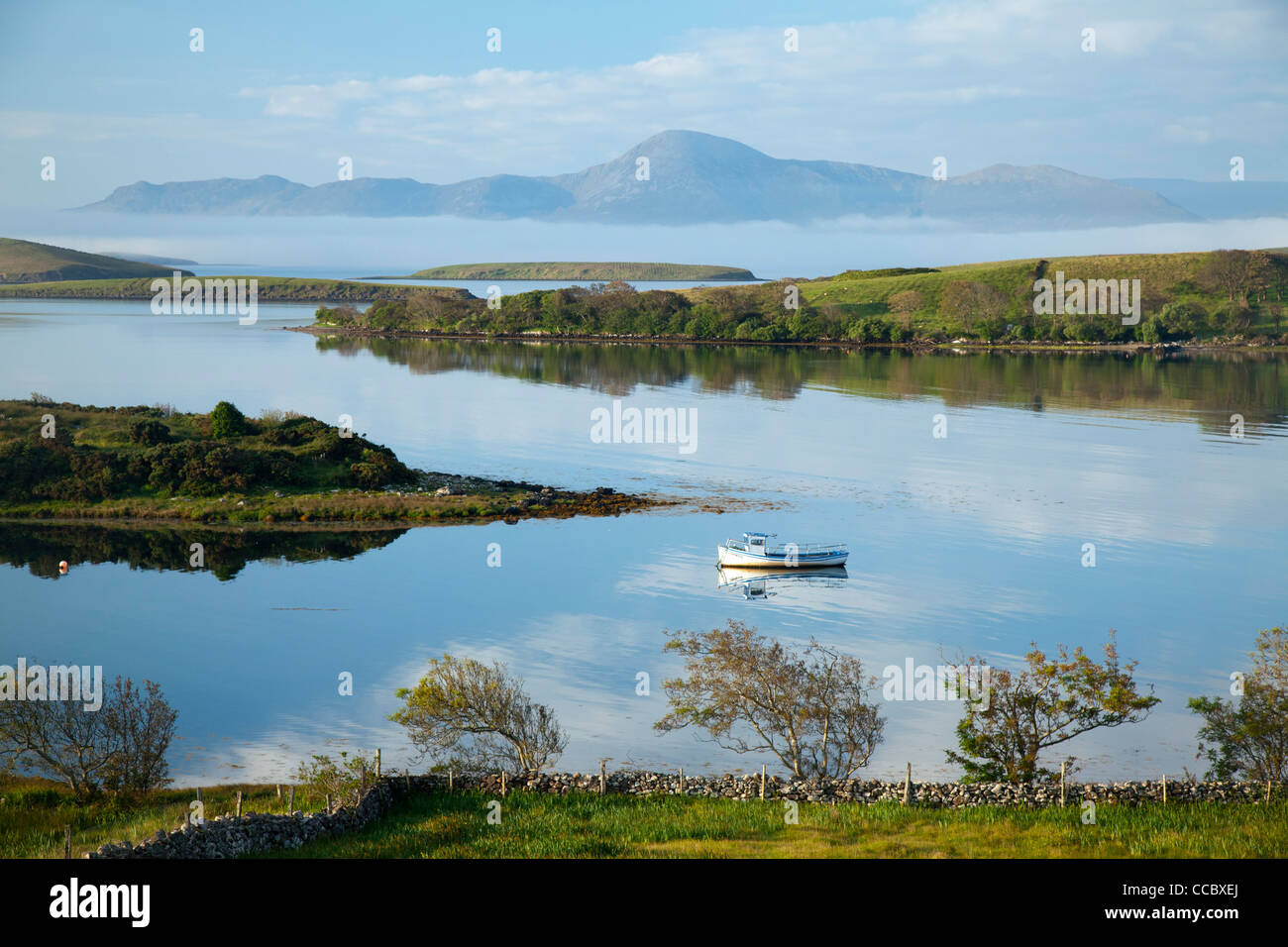 Fishing boat moored in Clew Bay beneath Croagh Patrick, County Mayo, Ireland. - Stock Image