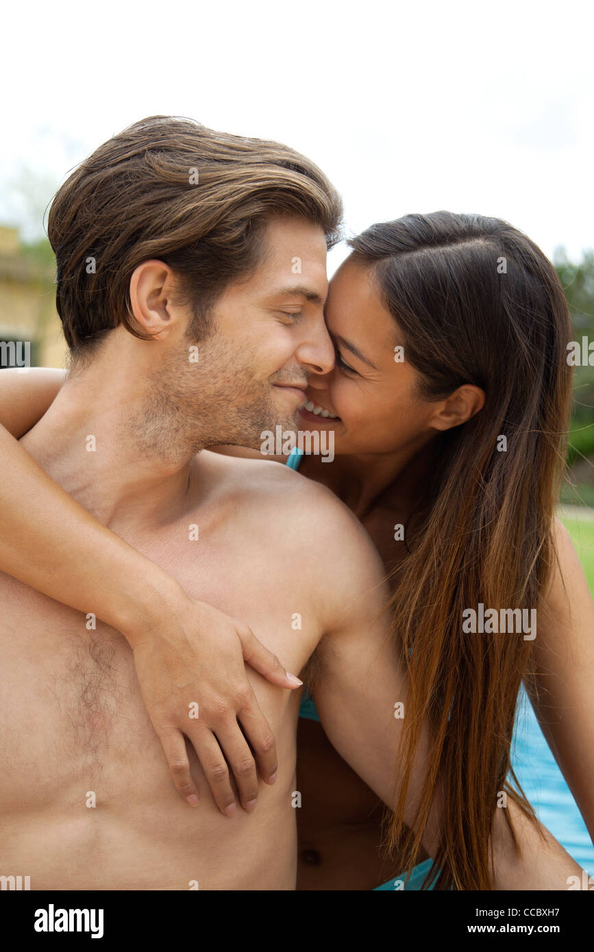 Couple embracing outdoors - Stock Image