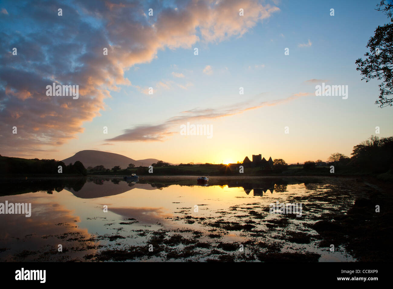 Sunset over Burrishoole Abbey, on the shore of Clew Bay, County Mayo, Ireland. - Stock Image