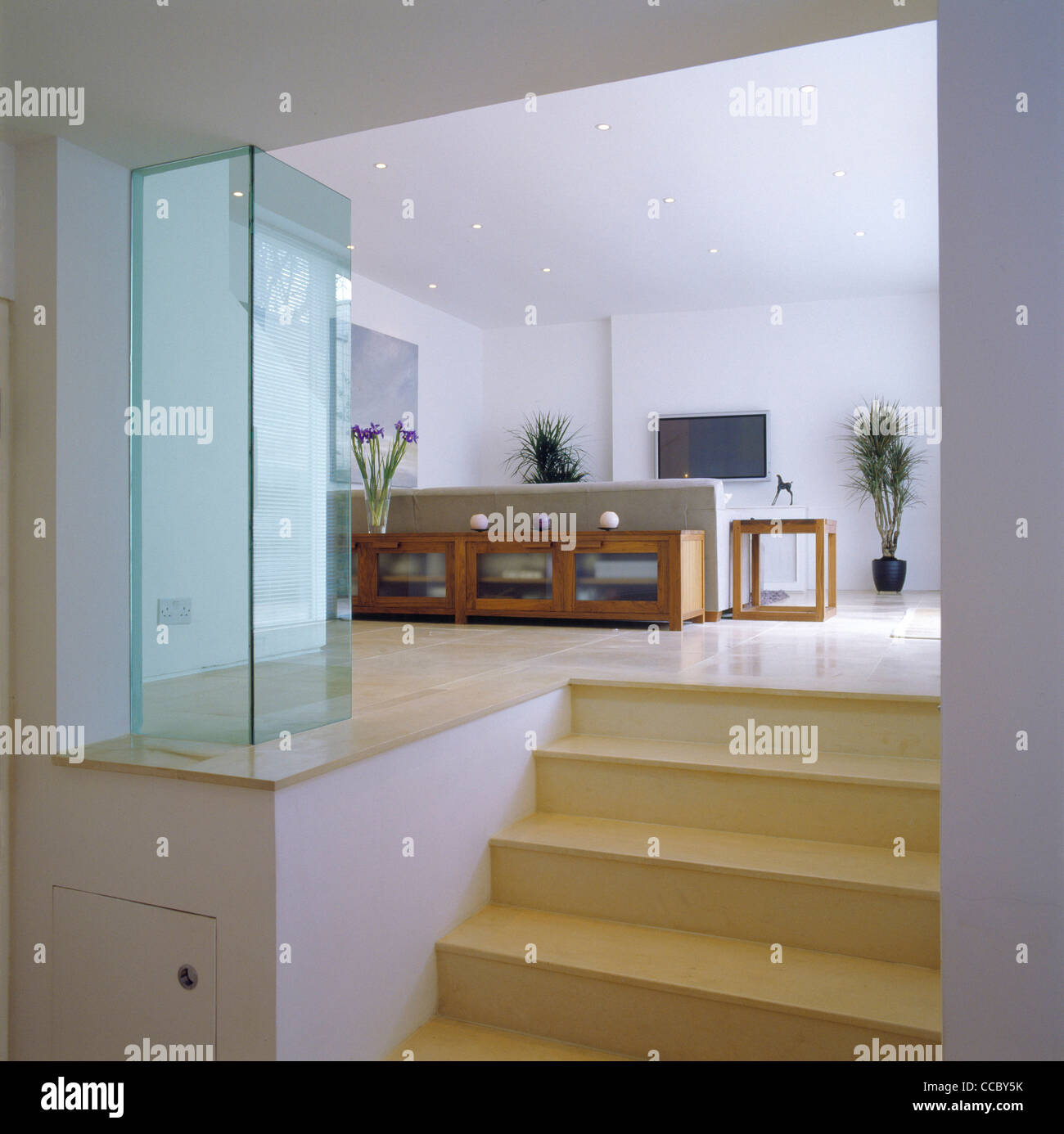 PRIVATE HOUSE STAIRS THROUGH TO LIVING ROOM - Stock Image