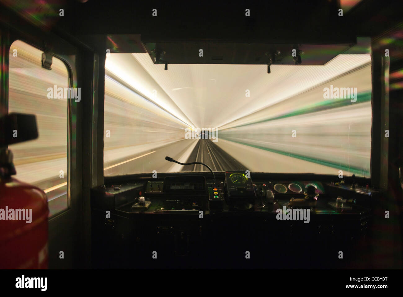 Train moving through tunnel, viewed through window - Stock Image