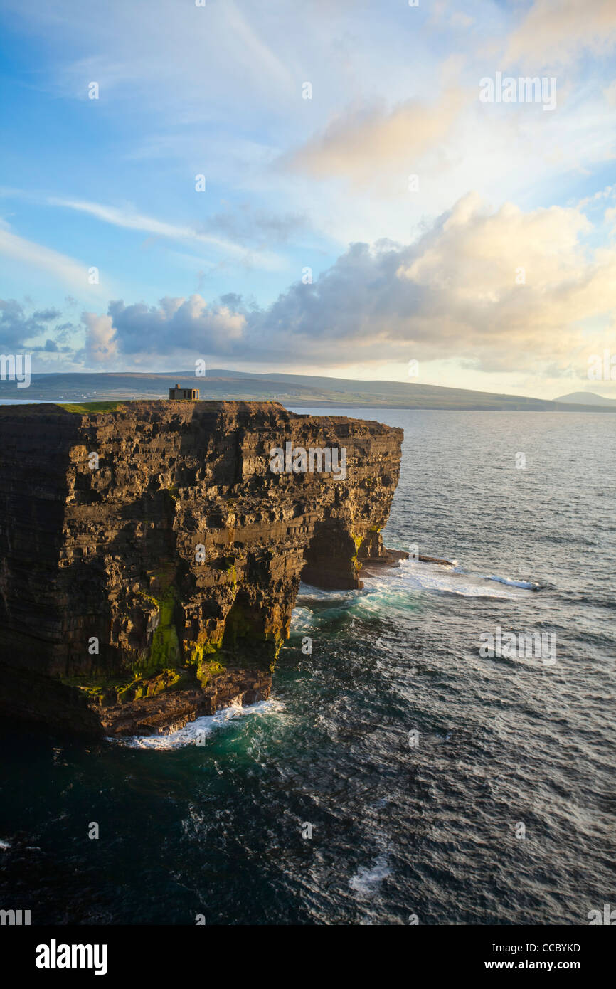 Evening light on the cliffs of Downpatrick Head, County Mayo, Ireland. - Stock Image