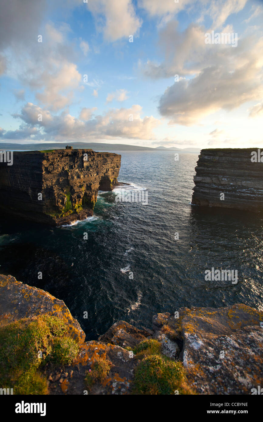 Evening over Downpatrick Head and Dun Briste seastack, County Mayo, Ireland. - Stock Image