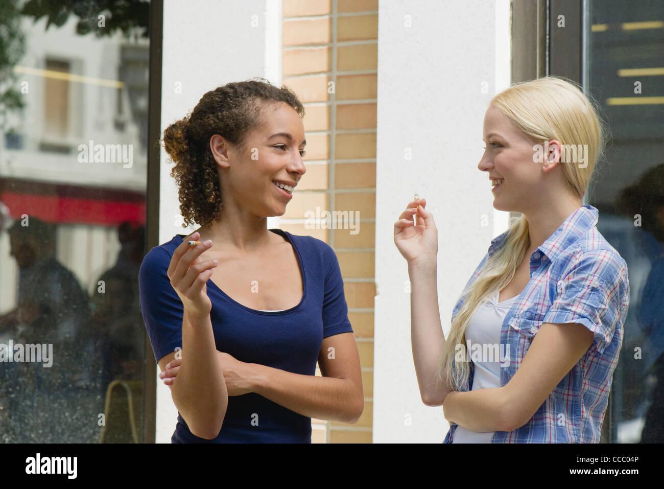 Young women taking cigarette break - Stock Image