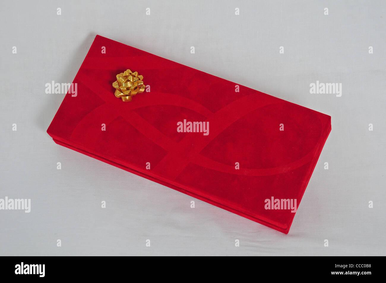 Velvety gift box with ribbon rosette. - Stock Image