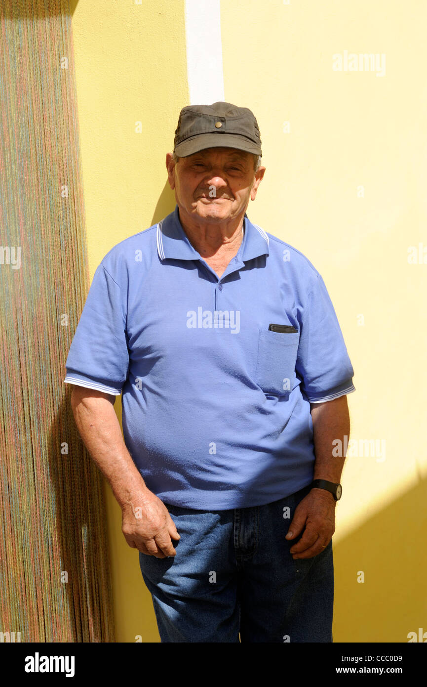 italy, basilicata, roccanova, man outside house - Stock Image