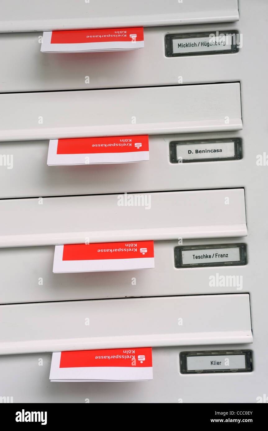 Leaflets for Sparkassen savings bank placed in residents mail boxes - Stock Image