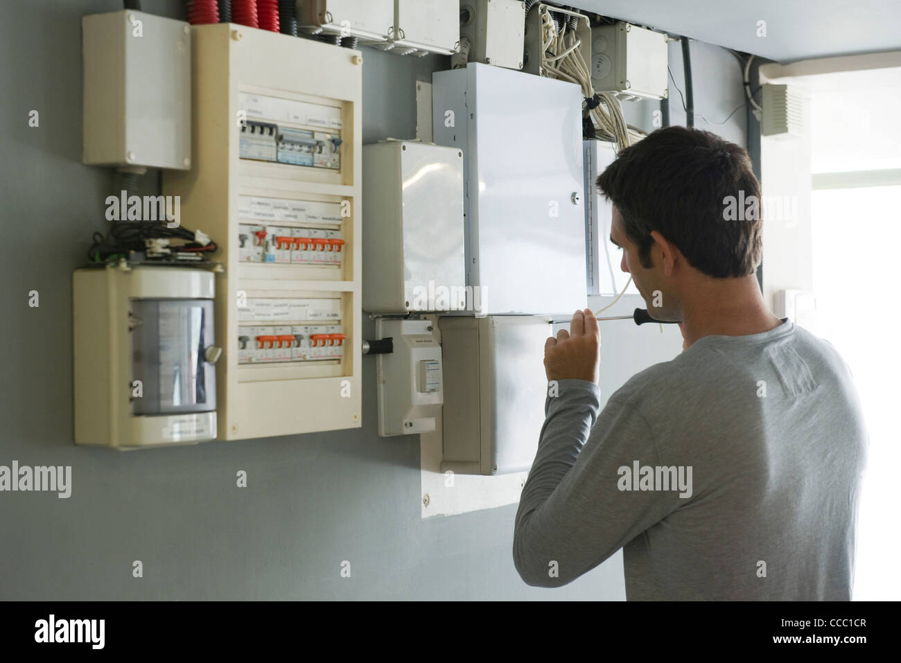 Domestic Fuse Box Stock Photos Images Alamy Ah Man Opening Rear View Image