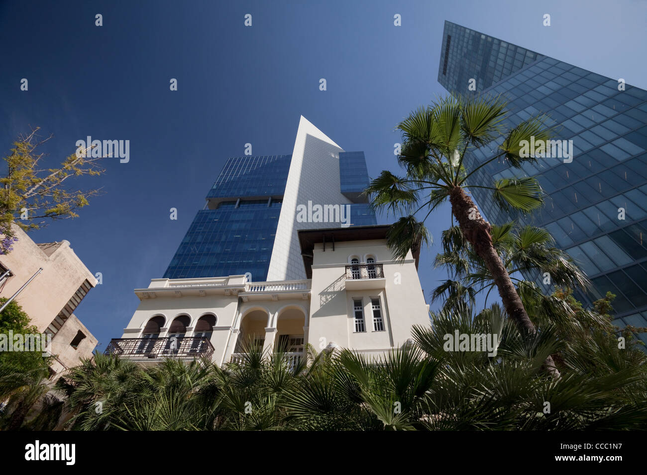 19th century villa dwarfed by modern buildings on Rothschild Boulevard Tel Aviv Israel - Stock Image