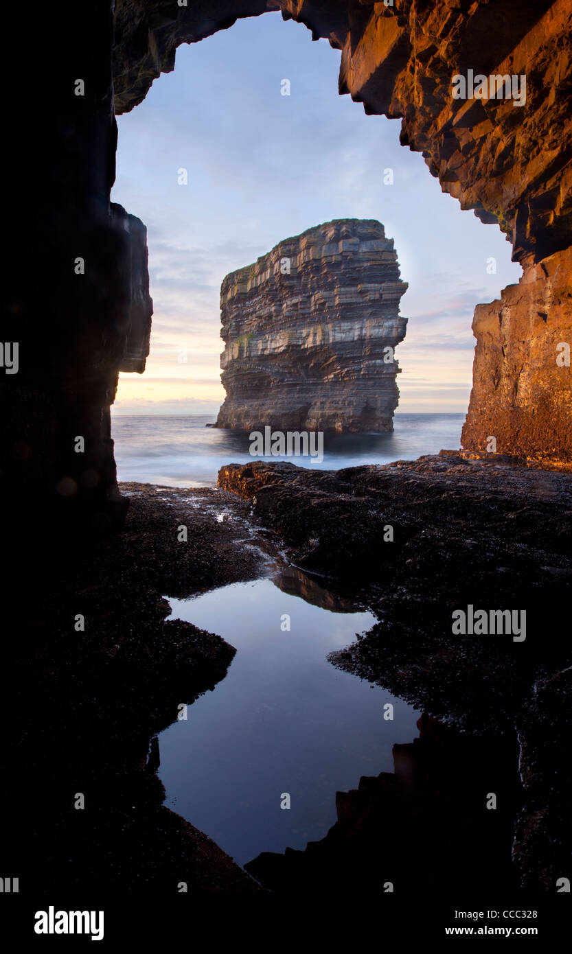 Dun Briste seastack seen from a cave beneath Downpatrick Head, County Mayo, Ireland. - Stock Image