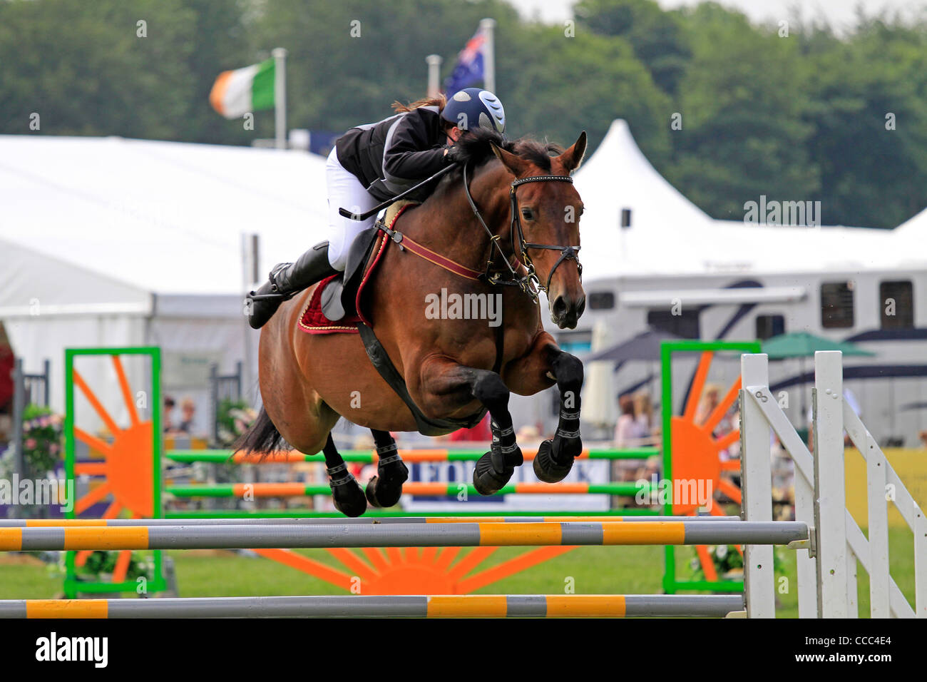 horse and rider fly over the jump at bramham - Stock Image