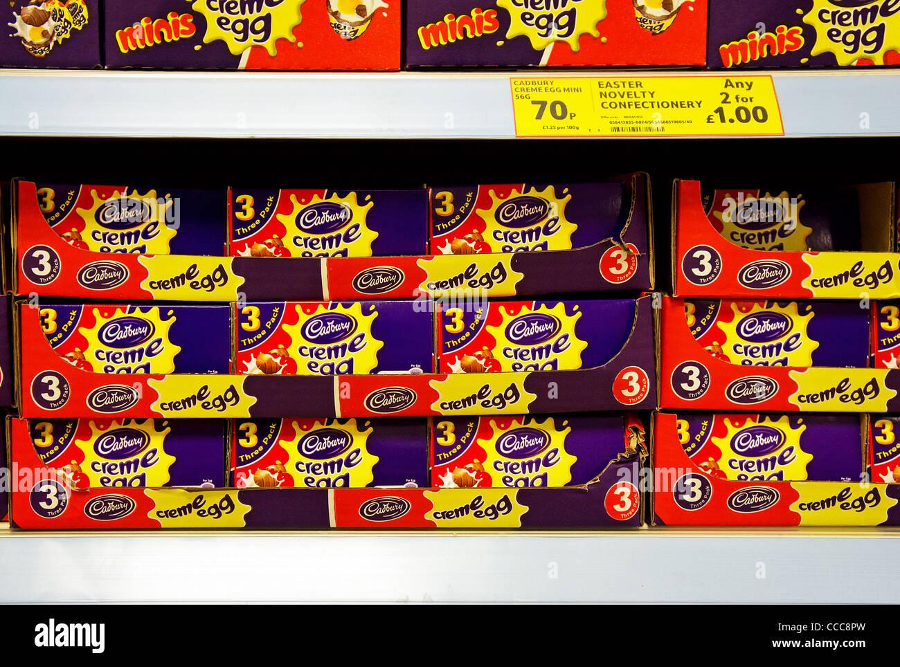 Cadbury creme eggs on a supermarket shelf, UK - Stock Image