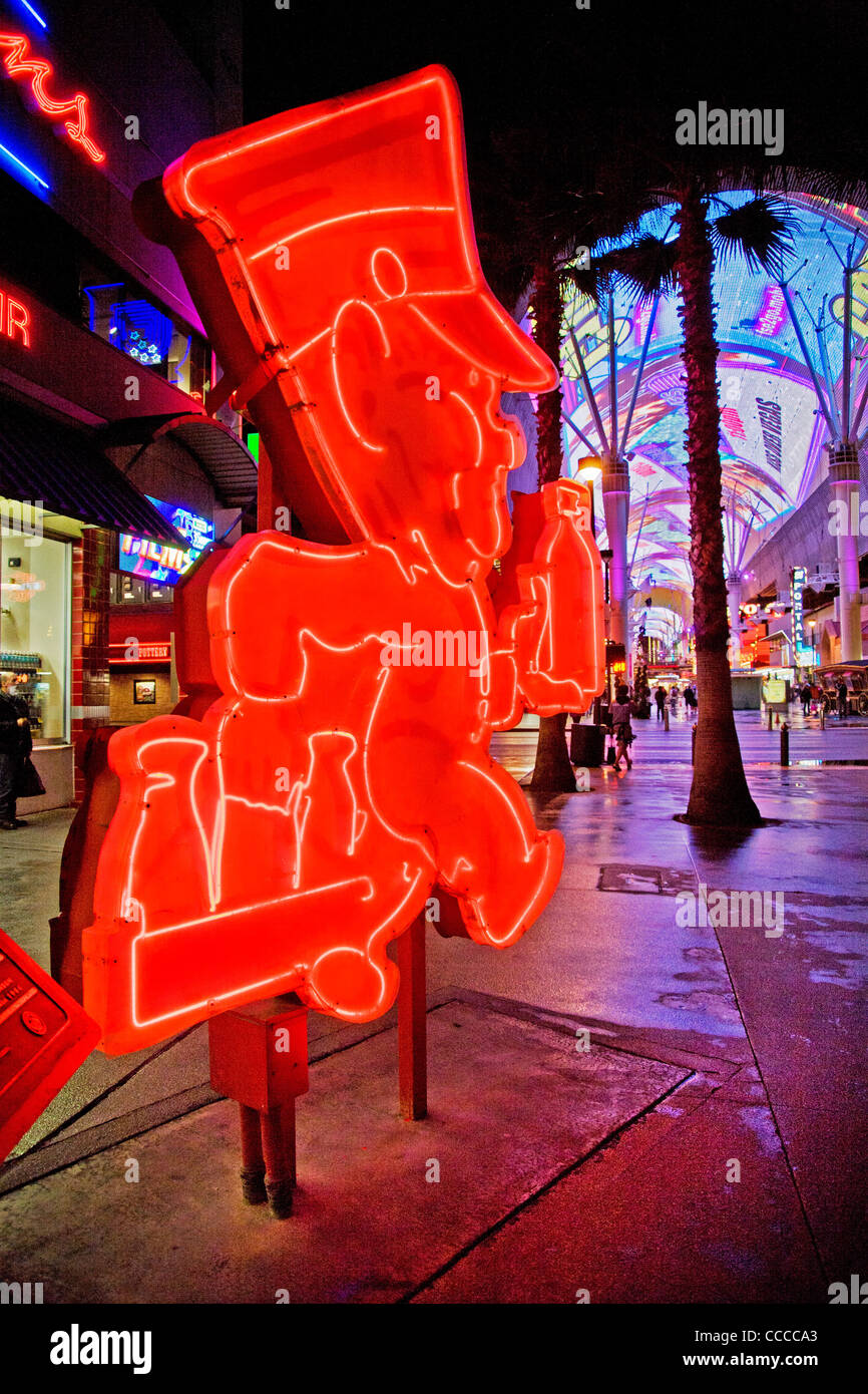 Andy Anderson, a milkman sign in red neon decorates Fremont Street in Las Vegas, NV,  part of the 'Fremont Street - Stock Image