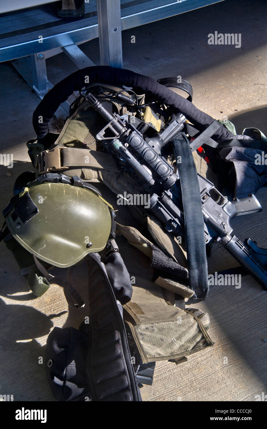 "An FBI SWAT (Special Weapons and Tactics) team's equipment is ready for a practice session at a ""Live Fire Kill Stock Photo"