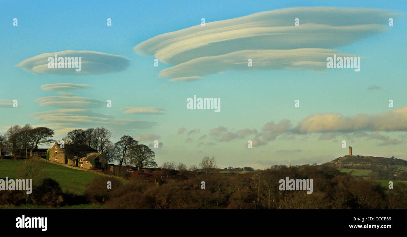 Lenticular clouds over Huddersfield UK - Stock Image