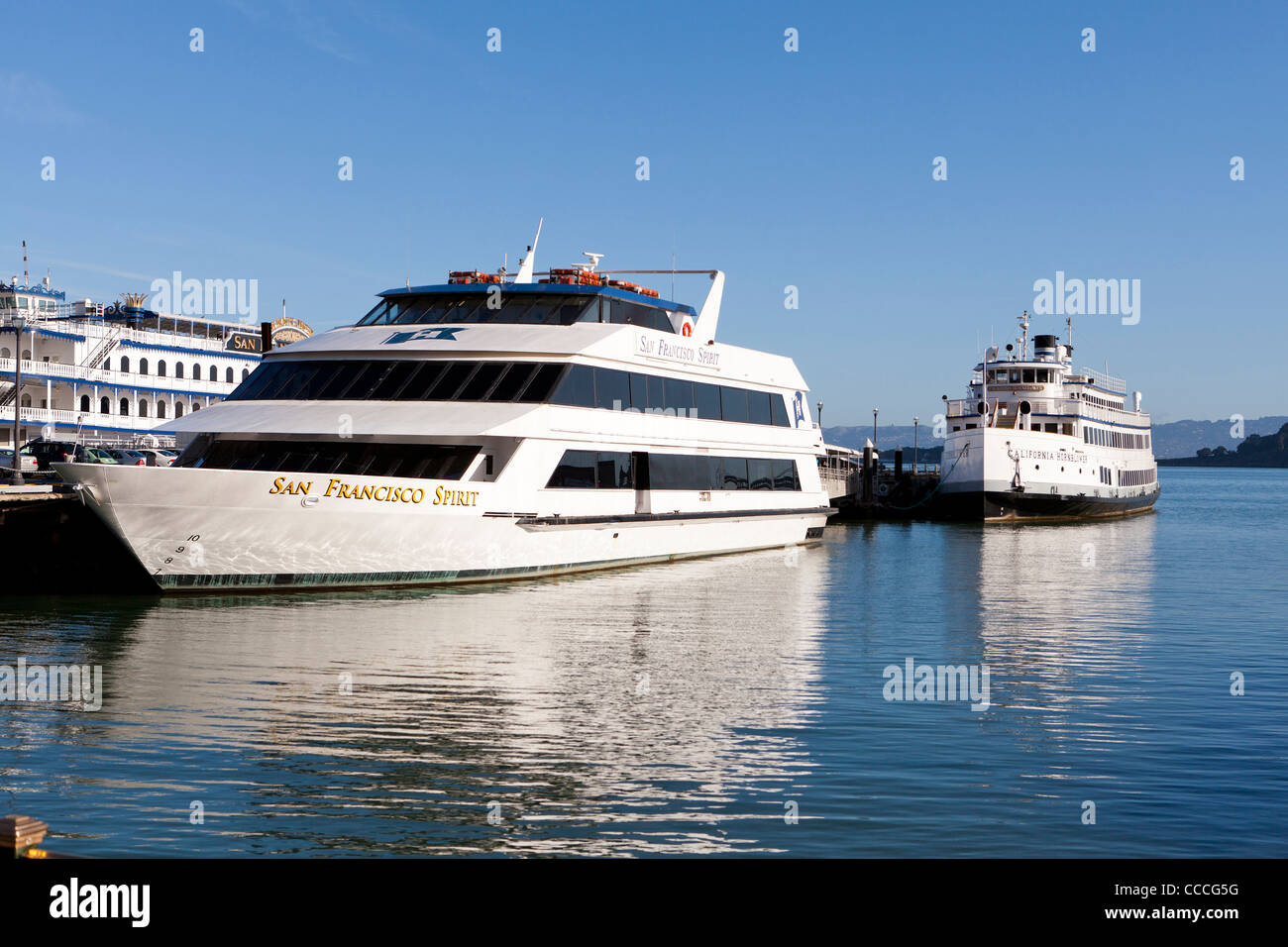 Private charter event cruise boats at dock - Stock Image