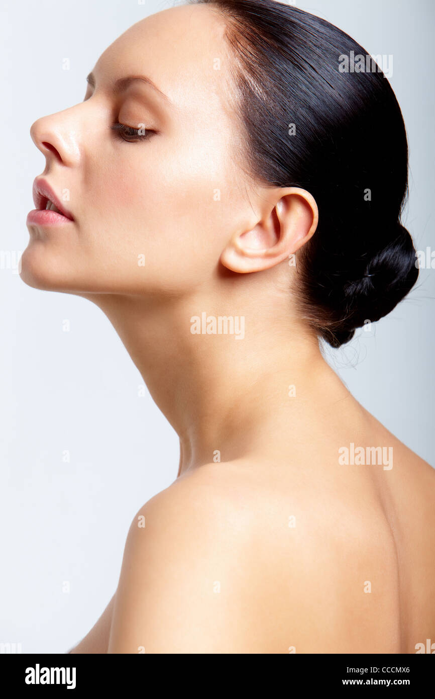 Perfect Woman Looking At Camera Over White Background