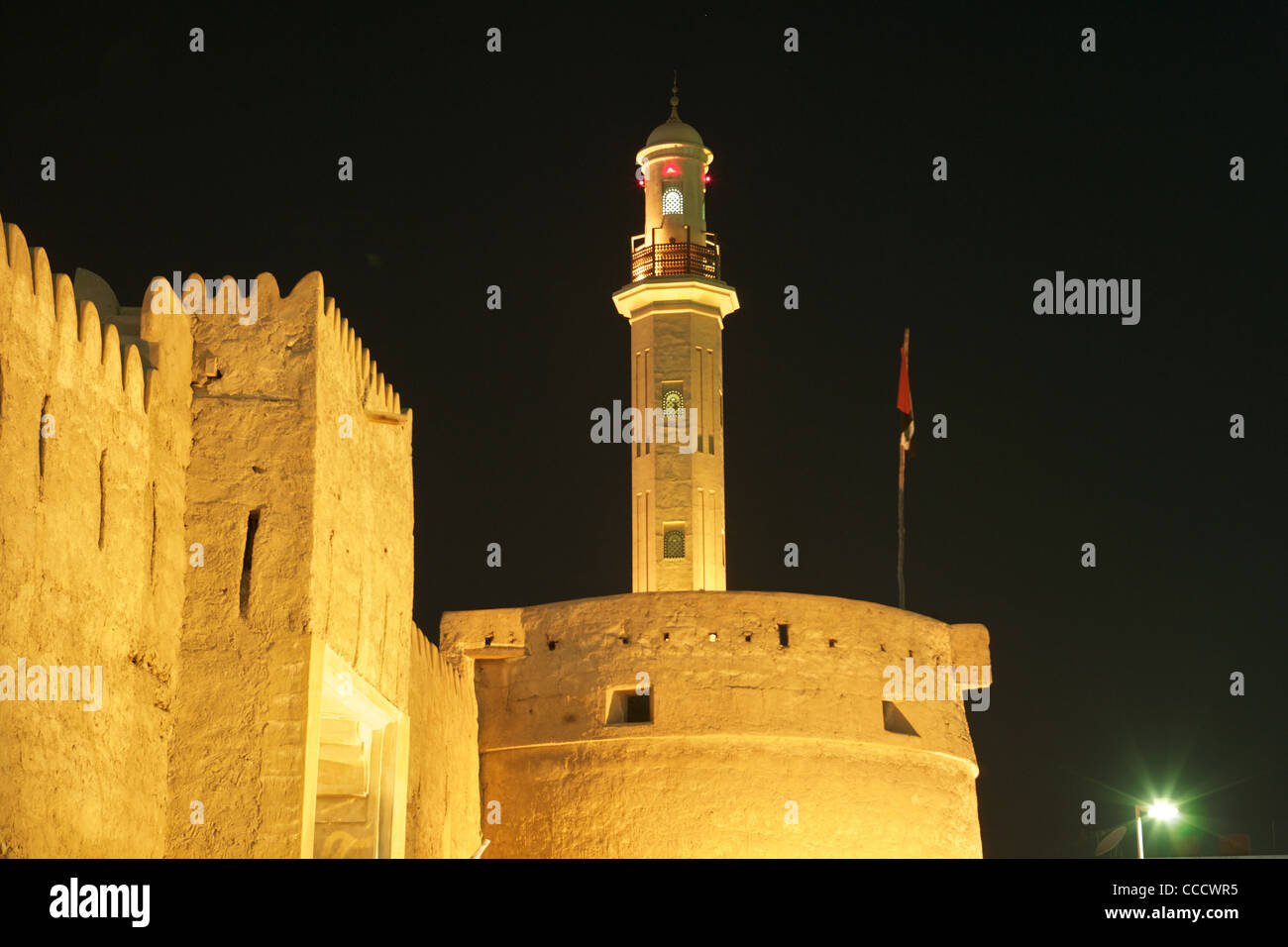 Al Fahidi Fort, the oldest building in Dubai, with a minaret in the background. For many years it was the Ruler's - Stock Image