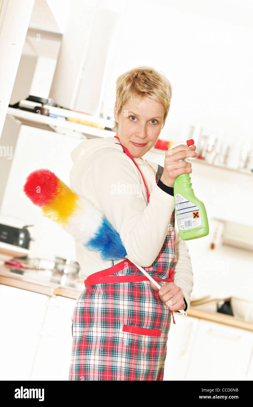 Woman with feather duster and spray flask - Stock Image
