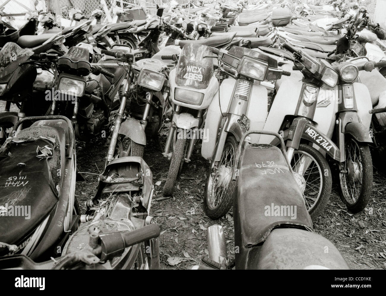 Documentary Photography - Motorbike scrapyard In Melaka Malacca in Malaysia in Southeast Asia Far East. Vespa Moped - Stock Image