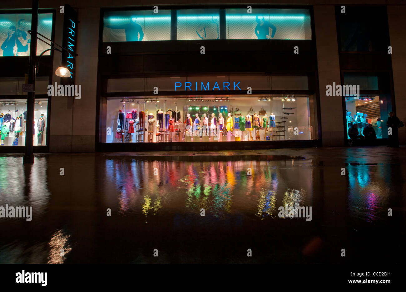 Primark shopfront and reflection in flood waters after water mains burst along Oxford Street, London, UK. - Stock Image