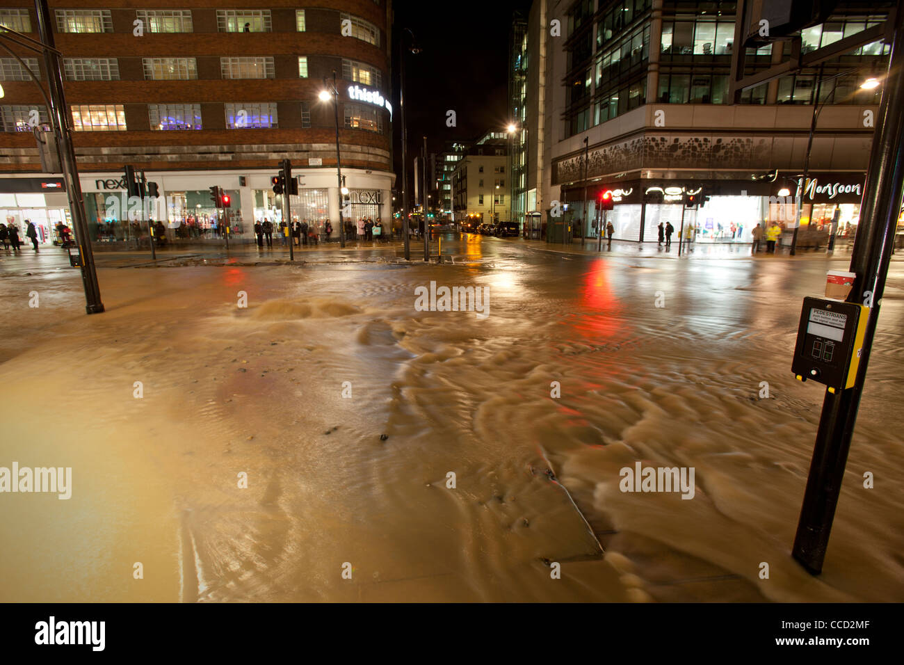 Water welling up on Oxford Street after water mains burst, 19th January 2012, London, UK. - Stock Image
