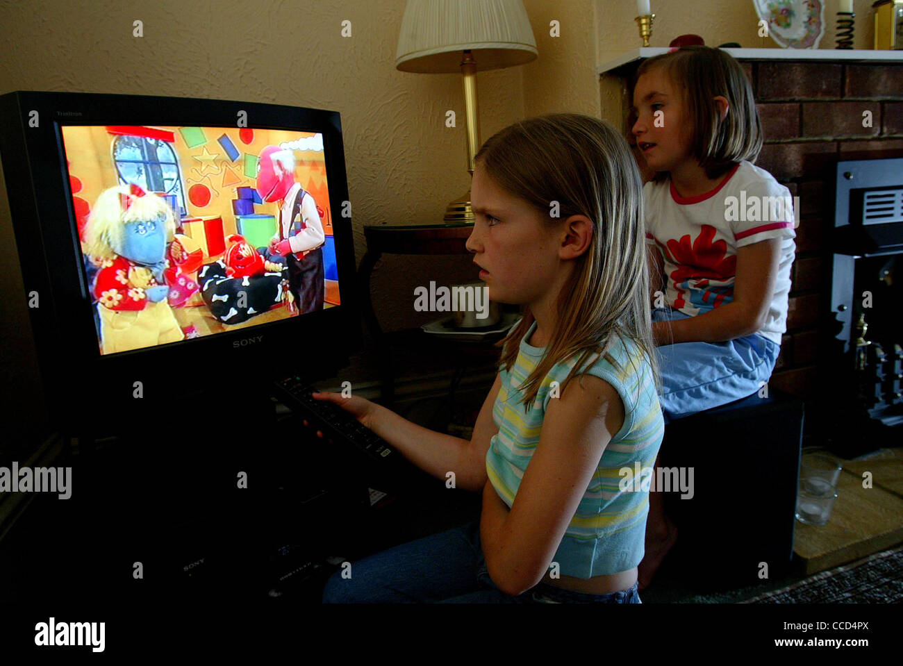 Children watching television. - Stock Image