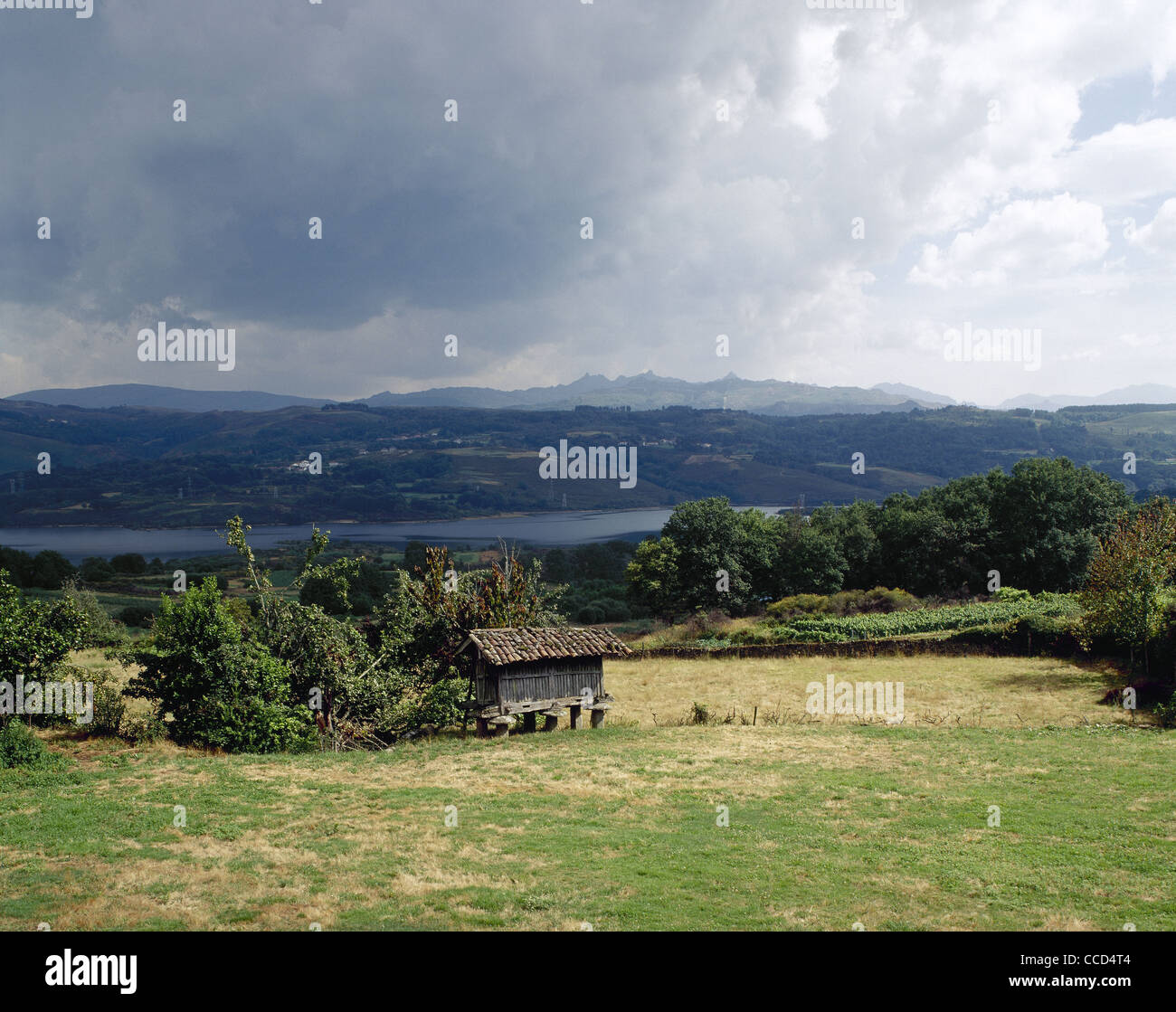 Spain. Galicia. Overview of a typical galician landscape with Reservoir Das Conchas in the background. - Stock Image