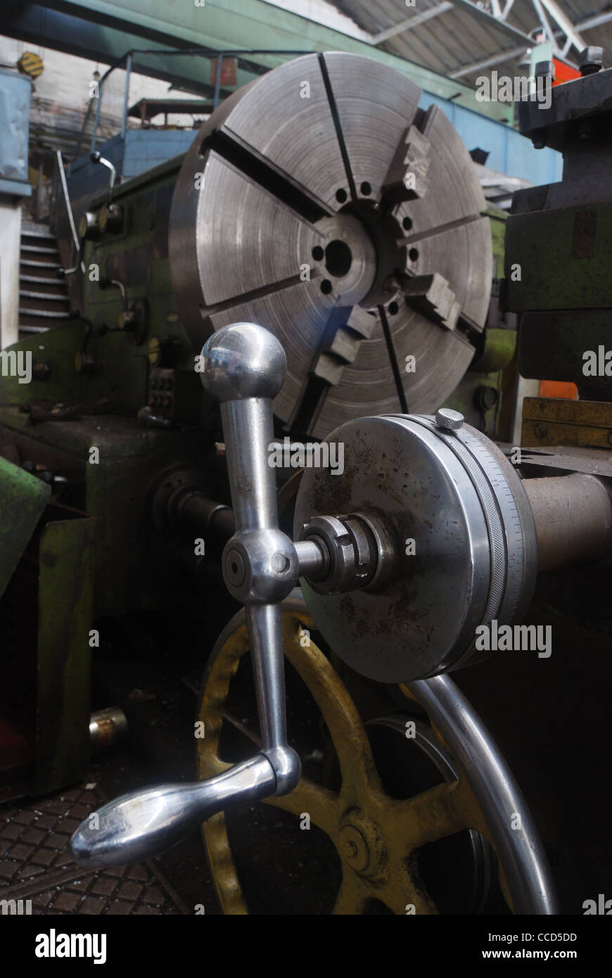 vertical photo of old lathe in the factory - Stock Image