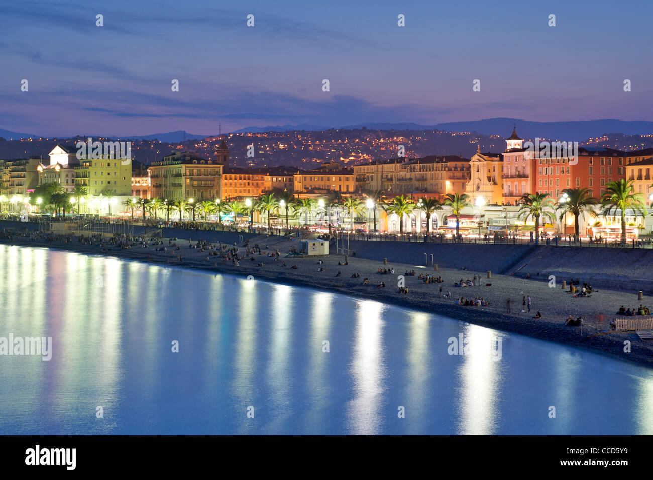 Night-time view of the Baie des Anges (Bay of Angels) the beach and the promenade in Nice on France's Mediterranean - Stock Image