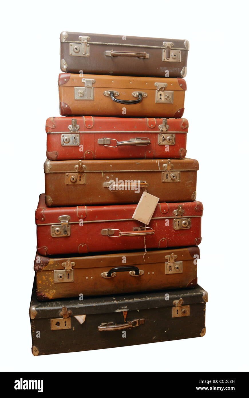 Pile of battered old suitcases and trunks in poor condition - Stock Image