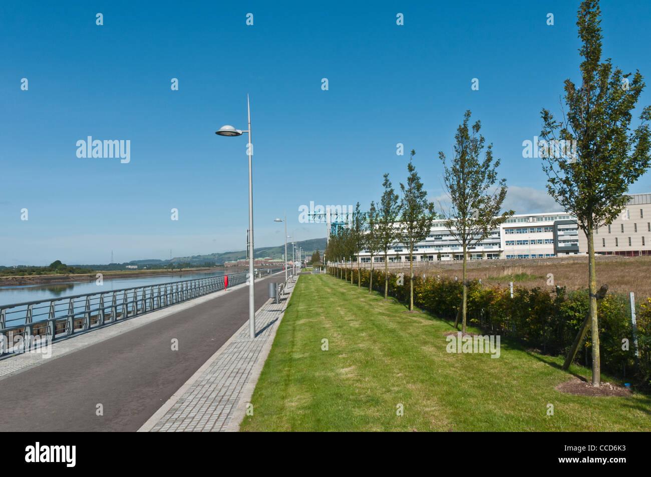 Walkway beside the River Clyde Clydebank West Dunbartonshire Scotland - Stock Image