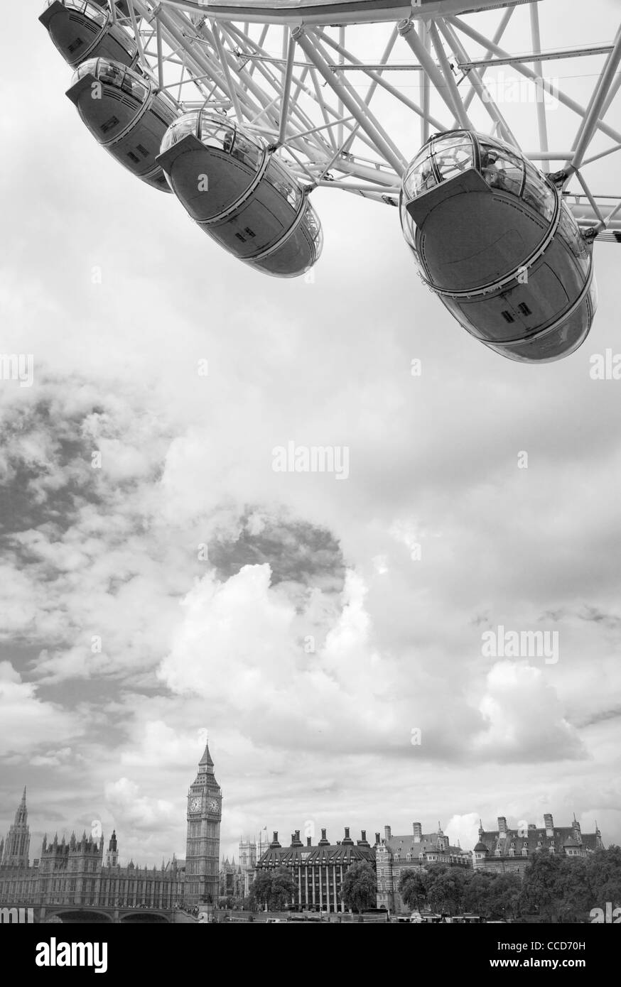 A detail of The London Eye ferris wheel and the north bank of the River Thames in the background, England. - Stock Image