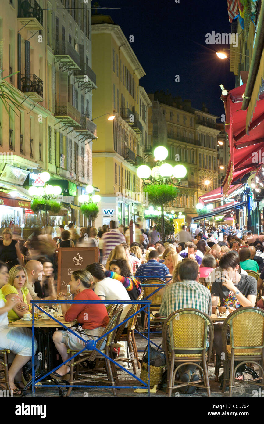 Night-time view of café patrons in the pedestrian zone of Rue Massena in Nice on the Mediterranean coast in - Stock Image