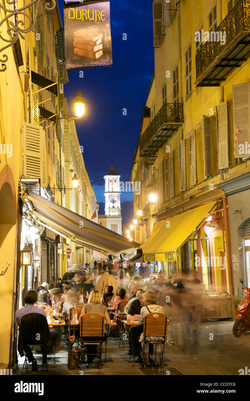 Night-time view of the streets and cafés in the old town of Nice on the Mediterranean coast in southern France. - Stock Image