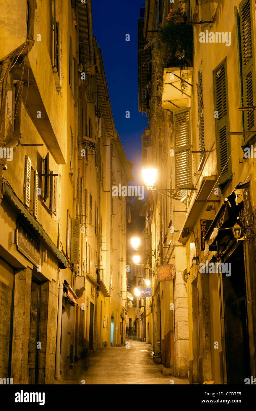 Night-time view of a deserted street in the old town of Nice on the Mediterranean coast in southern France. - Stock Image