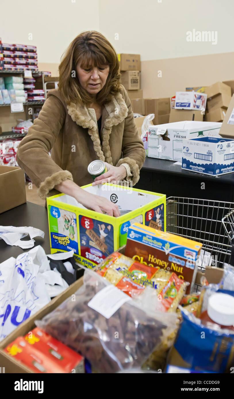 Volunteers Work at Food Pantry Stock Photo
