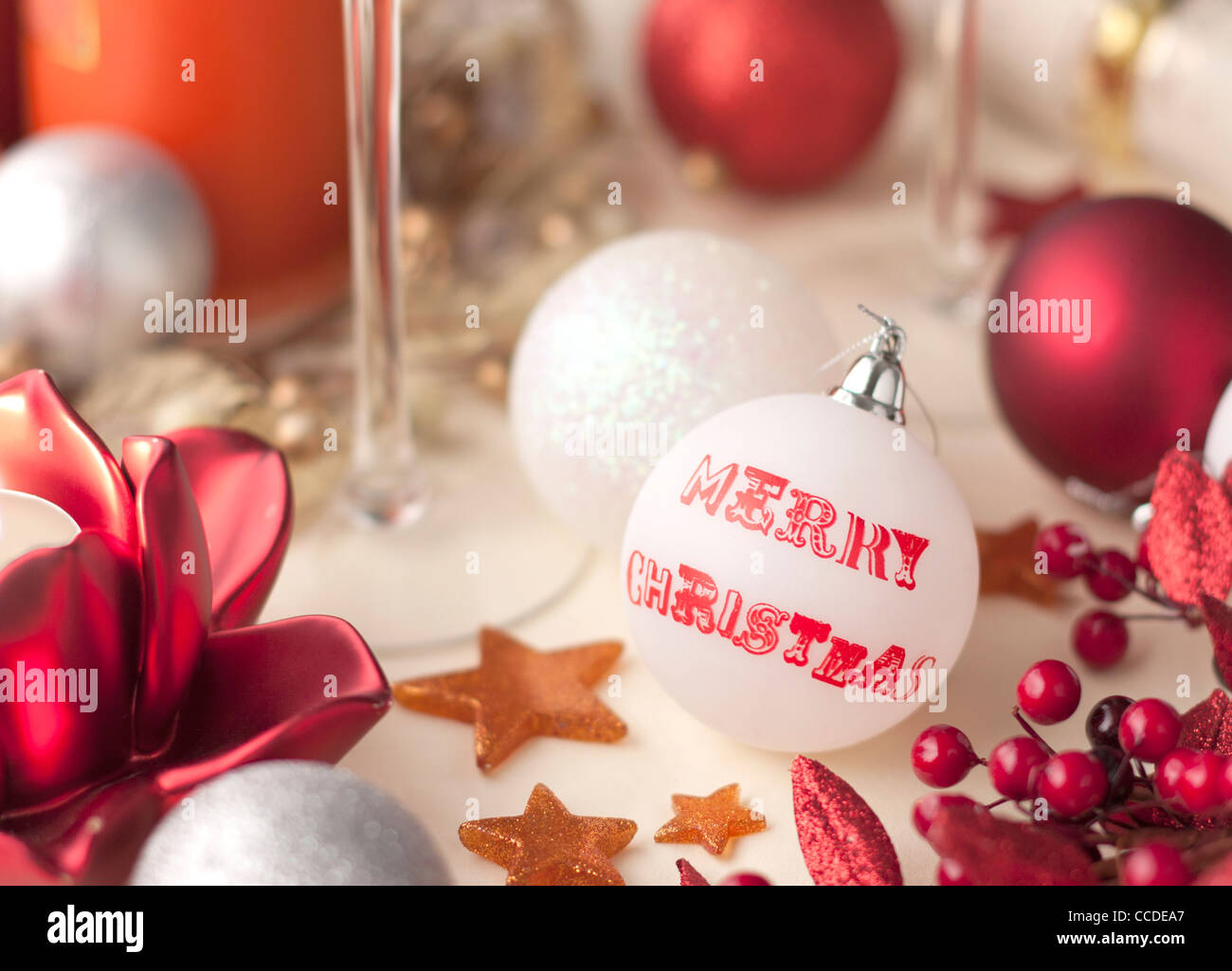 Christmas Table Decorated With Baubles And Festive Props In Red