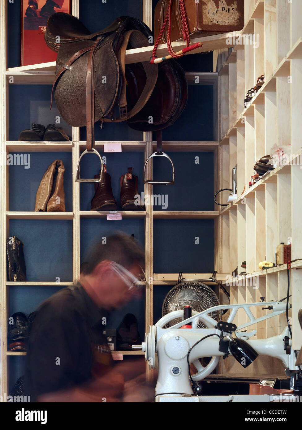 Interior and at work Cobbler Caballero is a new retail store bringing quality shoe repairs to the heart of sydney's Stock Photo
